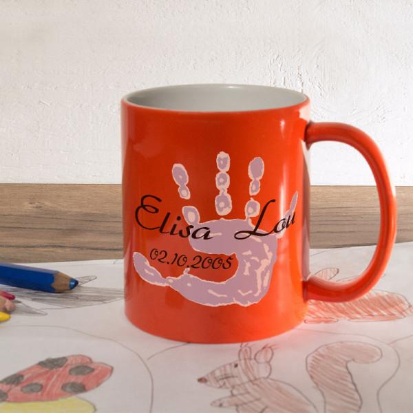 Personalisierte orange Zaubertasse zur Geburt mit Name und Datum
