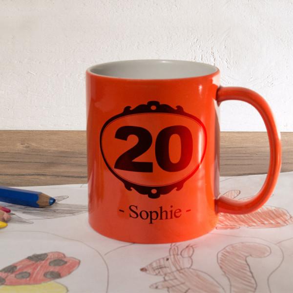 Orange Zaubertasse mit Wunschmotiv zum 20.
